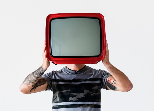 person-with-tattoo-holding-television-P52XRNF.jpg