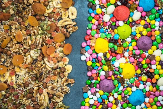 junk-food-and-sweets-contra-dried-healthy-snacks-PMX7VTR.jpg