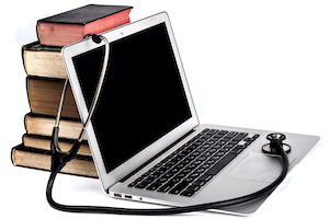 Balck Stethoscope on Laptop